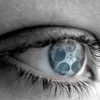 ronilynne: close up of a blue eye with a film reel in the iris (Default)