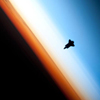 christomanci: A space shuttle hovering over the horizon of Earth. ([Space] Exploring Our Pale Blue Dot)