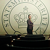 chaila: Birgitte standing in front of the seal of the Prime Minister. (borgen - statsminister)