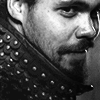 amihan: black & white close-up of howard charles as porthos in the tv series 'the musketeers', amused expression on his face ([the musketeers] porthos)