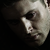ext_2260: It's a side profile image of Dean Winchester rotated face down 45 degrees, almost black and white and dark with angst. (SGA Sad-pensive Ronon)