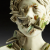 scallion: statue of woman with plants coming out of her mouth (inhabit)