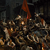pro_patria_mortuus: A few dozen fighters of the barricade sitting together at night, drinking and talking, with a red flag above them (where misery encounters the ideal)