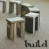 "genarti: Stonehenge made of hardcover books, with text ""build."" ([misc] a world of words)"