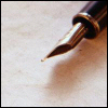 genarti: Fountain pen lying on blank paper, nib in close focus. ([misc] ink on the page)