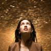 genarti: Woman looking up into gold bubbles. ([misc] magic in every moment)