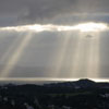 genarti: Bank of clouds with slice of sunlight and sunbeams emergine. ([misc] slanting sunbeams)