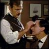 liviapenn: granada watson cleans a cut on holmes' face (holmes: my watson i think i'll keep him)