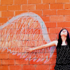 rootsofthestories: Someoen standing in front of chalk angel wings (writing: makeshift angels)