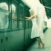 rootsofthestories: an angel person going onto a subway (universes: city angels)