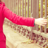 rootsofthestories: A girl wandering down a walkway her hand stretched out (writing: red coats wander)