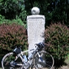 bikingandbaking: photo of my road bike in front of a statue of an apple (baldwin monument)