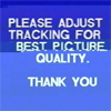 """cyberpunks: distorted vhs intro reading """"please adjust tracking for best picture quality. thank you"""" (please adjust tracking)"""