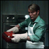 mayhap: Hannibal pulls a dish from his oven (oven mitts)