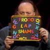 highlyeccentric: Bill Bailey holding board with magnetic letters reading 'Frodo lap shame' (Frodo lap shame)