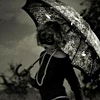 rei_c: B&W photo of woman holding an umbrella (Person:Umbrella)