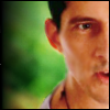 lannamichaels: Half of Methos's face, showing his necklace and the top of his shirt. (methos)