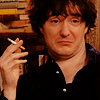 thingswithwings: Bernard Black with a silly face and a cigarette in his hand (Black Books - Bernard looking silly and)