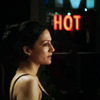 "sophinisba: Kalinda in a black bra, orange neon sign says ""HOT"" (kalinda hot by winterfish)"