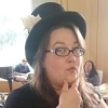 misskat: Kat in a top hat with her hand on her chin (Kat in Paul's Hat)