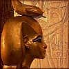 vaalea: Statue of Serqet near a wall with an Egyptian painting. (Kemet ~ Serqet ~ Protection)