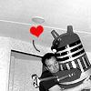 hyperfocused: DH and a big toy Dalek, hug w/heart. (DH and a big toy Dalek, hug w/heart., Dalek/David Hewlett)