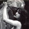 outlineofash: Vintage image of a woman embracing a draped figure much larger than her. (Fiction - Fantastika)