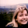 twinpeaks: Screencap of the video of Laura, smiling, on the mountain (pic#818999) (Default)