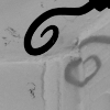 kaberett: curled decorative end of curtain rail casts a heart-shaped shadow on a wall (heartfruit)