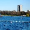 rydra_wong: Photo of the outdoor Serpentine Lido: a roped-off area of a lake, with a tower block visible in the background. (swimming -- lido)