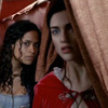 kaydeefalls: gwen/morgana peer out of tent nervously (something wicked this way comes)