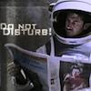 esteefee: JFlan in space suit rading a newspaper (dnd)