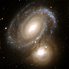 leesa_perrie: icon of two galaxies close to each other (Space)