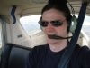 crazyscot: Self-portrait of me in a light aircraft aloft (flying)