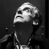 nightdog_barks: The 12th Doctor in black and white, looking up (Doctor Who Twelve)
