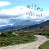 naye: a hilly road winding towards distant mountains (miles ahead)