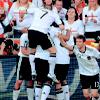attie: A group hug of German national team football players. (footie - group hug)