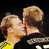 attie: Manuel Neuer with his face buried in Mertesacker's neck. (footie - merte/manu)