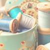 attie: Several rolls of thread in a cute round box. (misc - yarn)