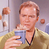 attie: Kirk staring at a tribble in his drink (st - kirk tribble in a cup)
