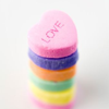 st_aurafina: stack of pastel coloured candy hearts (Hearts: Candy hearts)