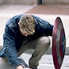 lonelywalker: Captain America in civvies, hiding behind his shield (captain america: shield)