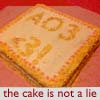 enigel: huge cake with text 'AO3 <3!' on cake and caption 'the cake is not a lie' (AO3 - with us cake is NOT a lie)
