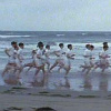 royalfireworks: A shot of the famous scene from the film Chariots of Fire, with all the Olympic hopefuls running on the beach. (Default)