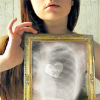 tropiavera: a woman x-rays her chest to display a heart ([❣] the heart is not coal)