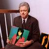 maevele: bill clinton with joan jett album cover and headphones (bill lives joan too)