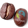 ironed_orchid: two coffee beans with the fairtrade logo stamped on one (fair trade coffee)