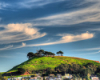 cledon: San Francisco hill with dramatic pink clouds (Bernal Clouds)