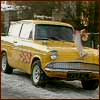 quinara: Vyvyan's car from The Young Ones: a yellow Ford Anglia with flames up the side.  And a leg attached to the bonnet. (Vyvyan car)