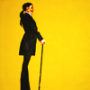 meloukhia: A figure in profile against a yellow background with a cane and a pulled-back hairstyle (Profile with cane)